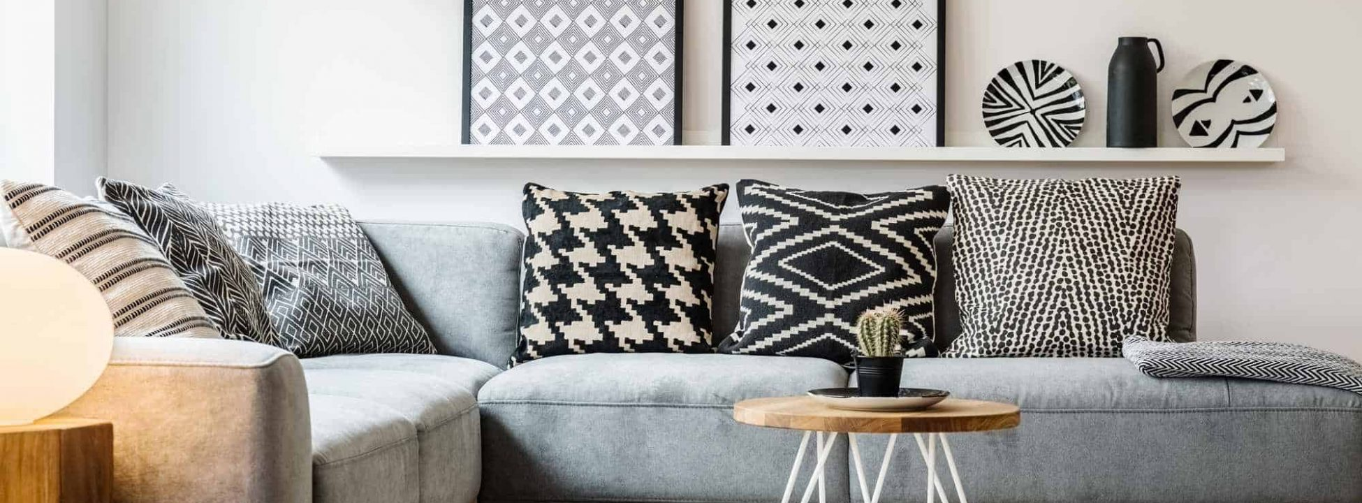 photodune-22350383-patterned-pillows-on-grey-corner-sofa-in-apartment-interior-with-xxl-1